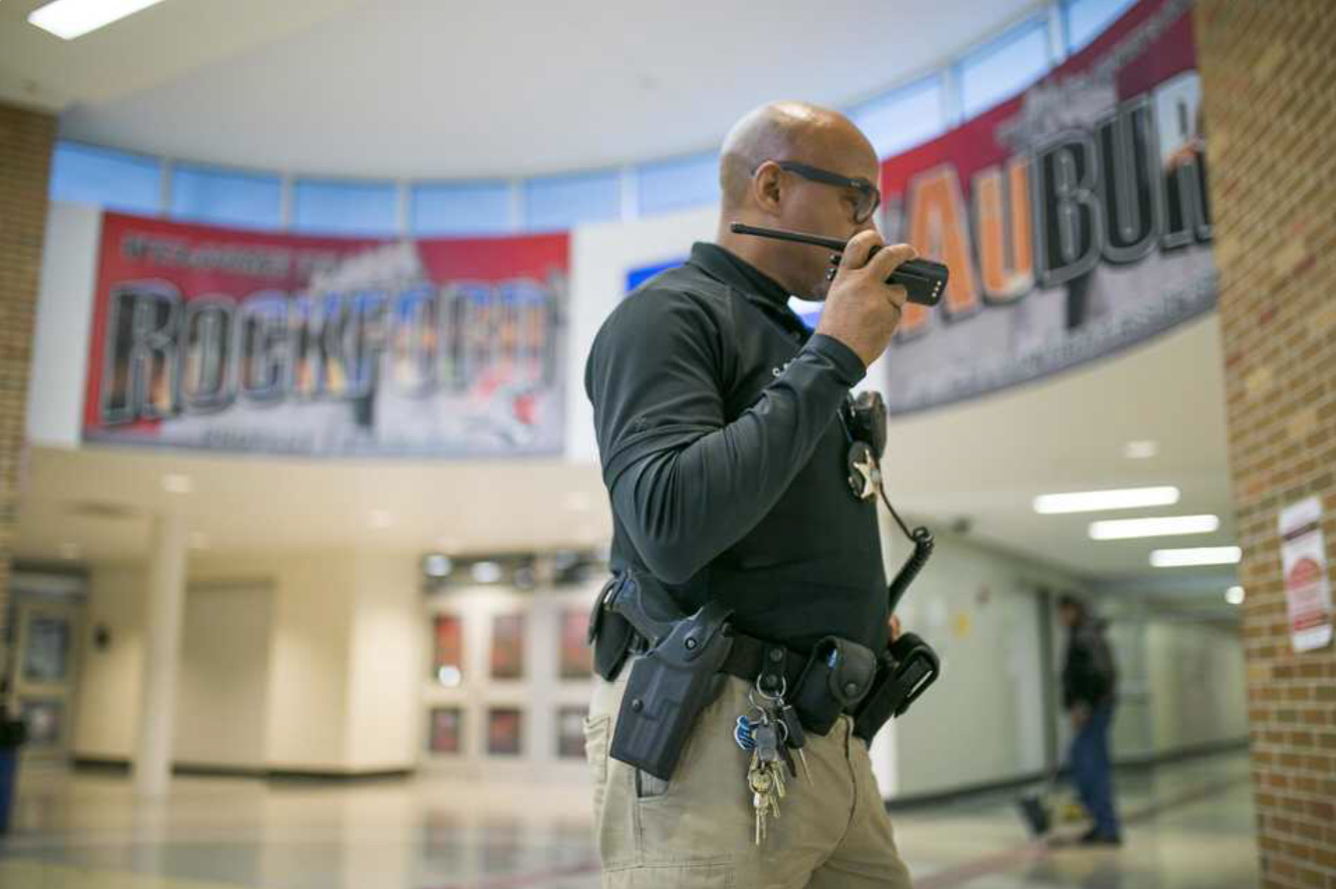 School resource officer Curtis Sockwell, a member of the Rockford Police Department, walks the halls on Thursday, Nov. 7, 2019, at Auburn High School in Rockford. [SCOTT P. YATES/RRSTAR.COM STAFF]