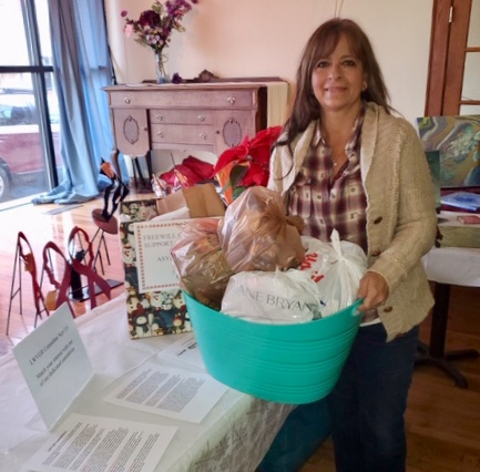 Attendees at the LWVGR Holiday Party, Sun., December 8, 2019, were generous with donations of toiletries, undergarments, and other necessities for refugee border detainees. Linda Zuba thanks everyone who contributed.